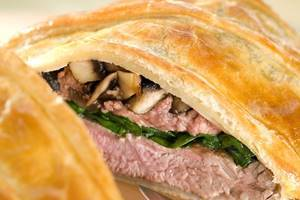 Lamb Wellington with spinach and mushrooms