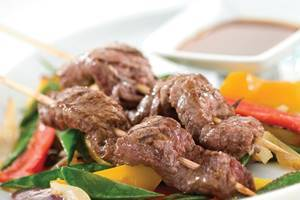 Beef teriyaki skewers with stir fry vegetables